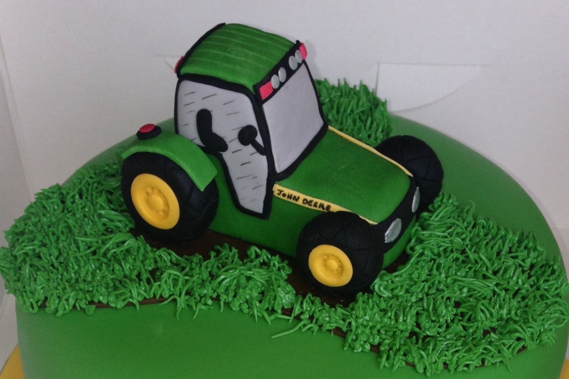 This is a photo of Dynamite John Deere Cupcake Toppers
