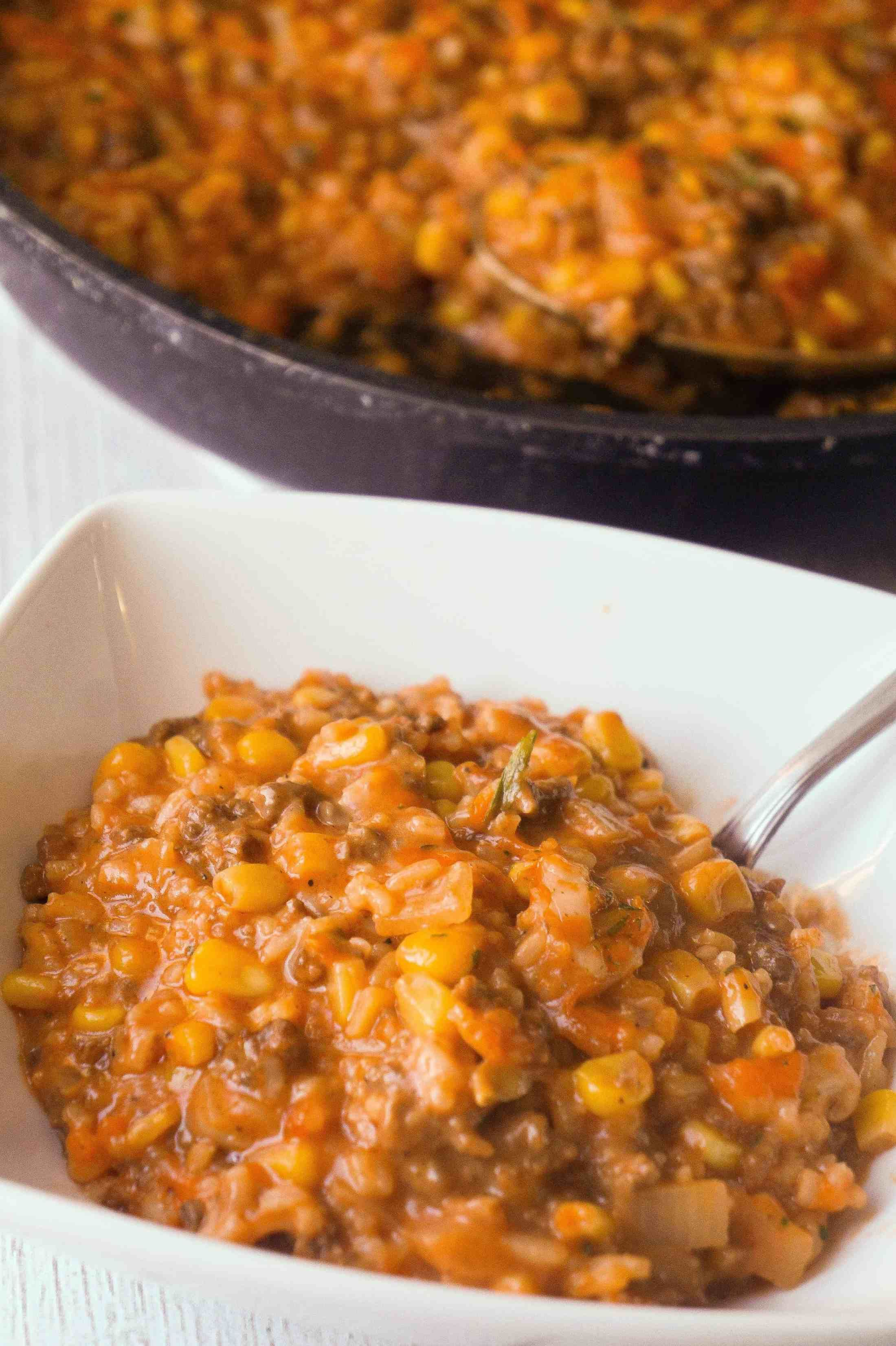 Cheesy Tomato Ground Beef And Rice Is An Easy Stove Top Dinner Recipe Packed With Flavour This Best Ground Beef Recipes Ground Beef Recipes Top Dinner Recipes