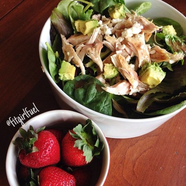 Early dinner before I go play in some scrimmages Mixed greens salad with chicken, feta, and avocado topped with light raspberry vinaigrette and strawberries on the side❤️