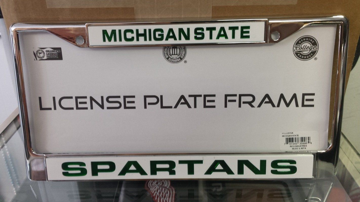 NCAA Michigan State Spartans Silver / White Laser Chrome License ...