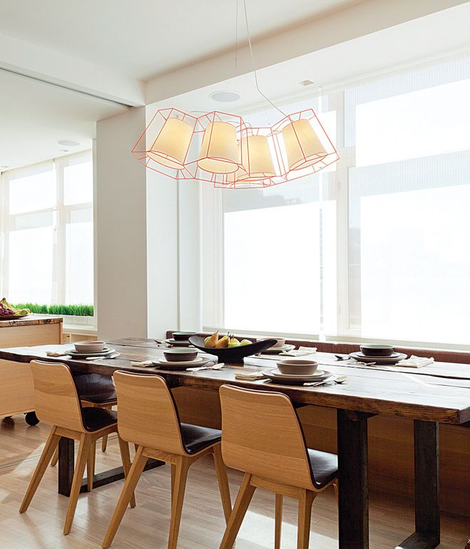 In The Dining Area Of A Wext Village Apartment An Exofly Pendant By