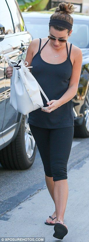 Sporty: The actress bared her back in revealing tank top which she paired with leggings an...
