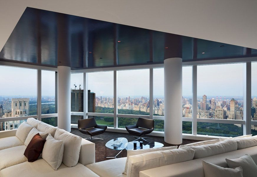Modern Duplex On 70th Floor Of The Time Warner Center Has Dark Carpet Stand Alone Columns Large White Couches Leather Chairs Glass Coffee Tables
