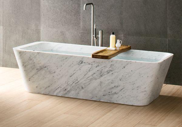 Neutral tones. Carrara marble bathtub. Blonde wood floor