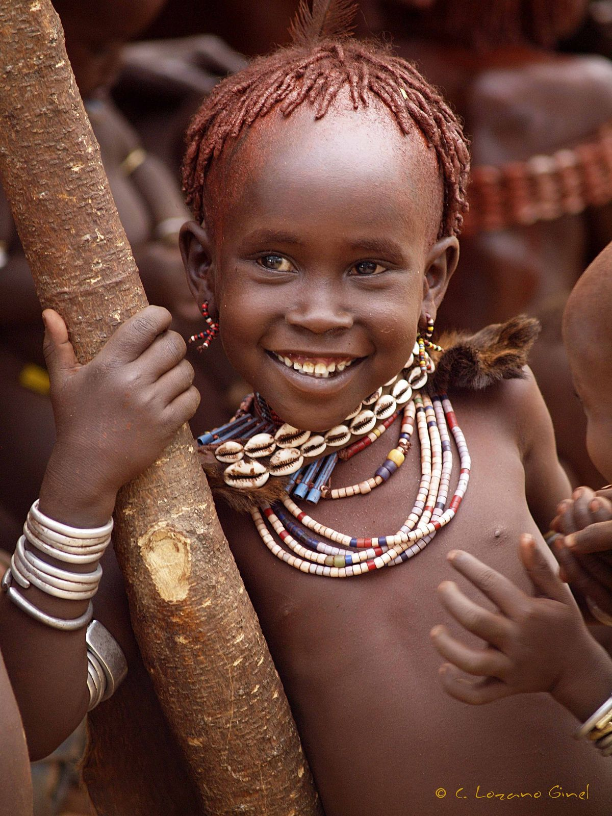 Melting hearts with a sincere smile   Hamar girl in Ukuli Bula.  Ethiopia   Africa©Carlos Lozano Ginel