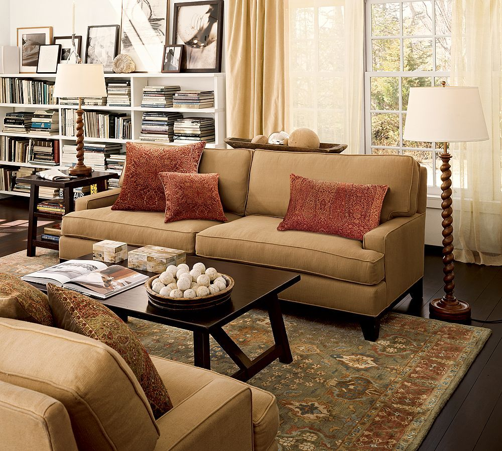 Pottery barn living room  benjamin moore paint color af frostine khaki seabury sofa with red paisley pillows metropolitan cube side also