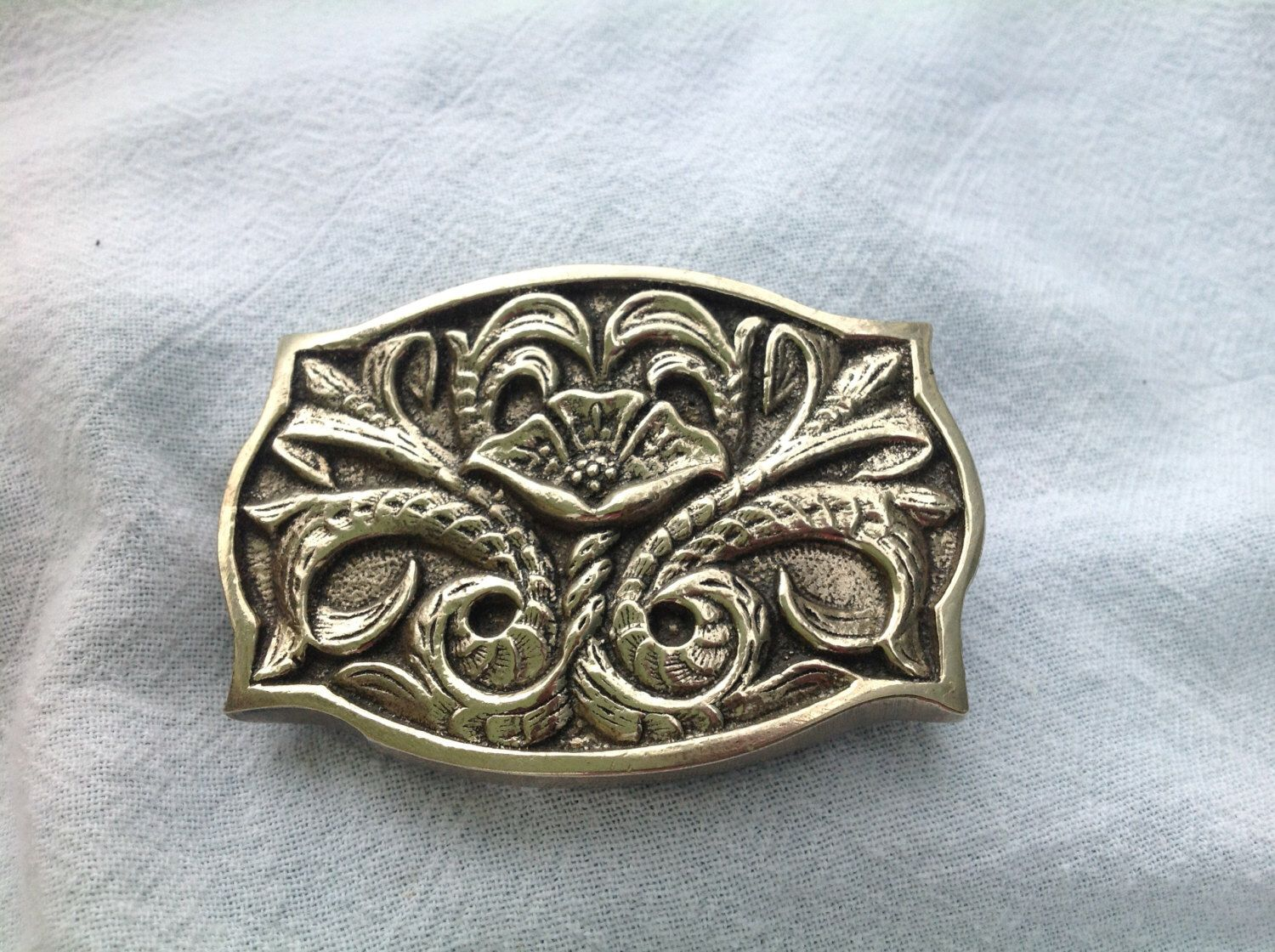 A personal favorite from my Etsy shop https://www.etsy.com/listing/247650928/german-silver-belt-buckle-highly-ornate