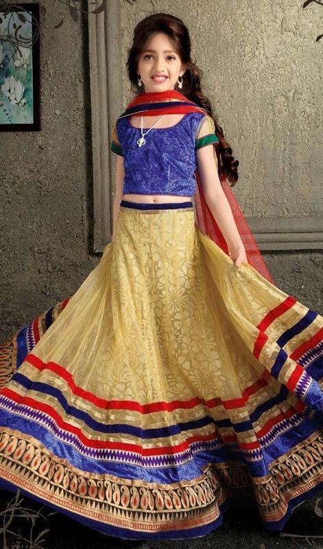 Dazzle the masses at a glance dolled up in this girl lehenga choli, net fabric in beige color. The ethnic lace work over a attire adds a sign of elegance statement with your look. Upon request we can make round front/back neck and short 6 inches sleeves regular lehenga blouse also. #LatestStyleGirlsChaniyaCholiDesign