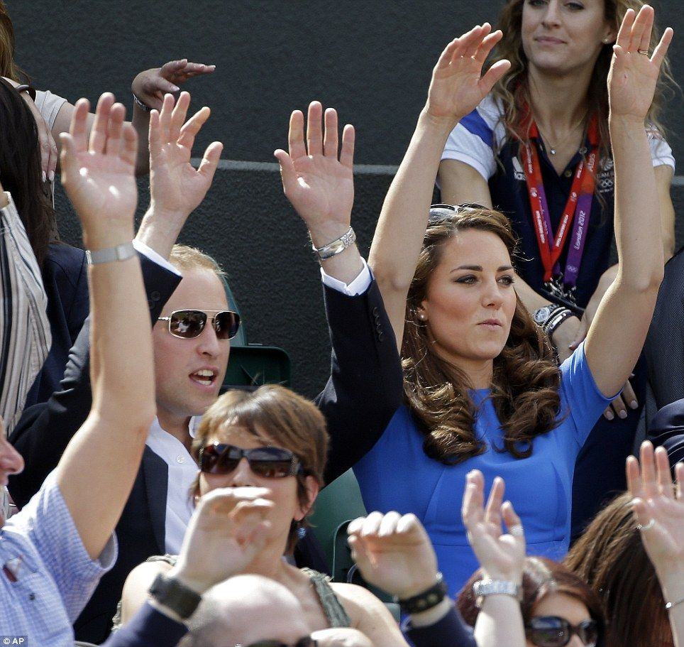 Prince William and Kate joined the crowd in doing the wave at the match between Andy Murray and Nicolas Almagro at the All England Lawn Tennis Club at Wimbledon today