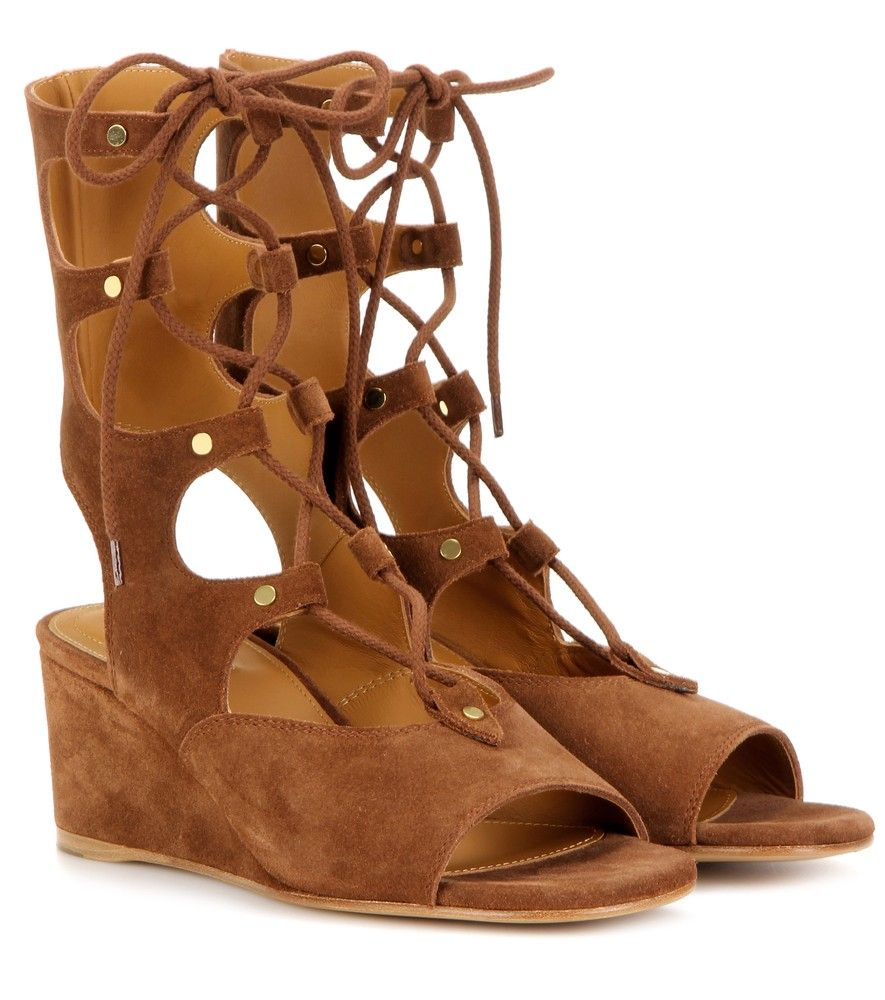 Chloé - Foster suede gladiator wedge sandals - Hailed as the shoes of the season by top fashion editors and the fashion elite, these wedge gladiator sandals from Chloé are the must-have accessory of the summer. The unique lace-up design travels up the leg, leaving a bare heel and open toe. Wear to add off-duty glamour to looks day or night. seen @ www.mytheresa.com