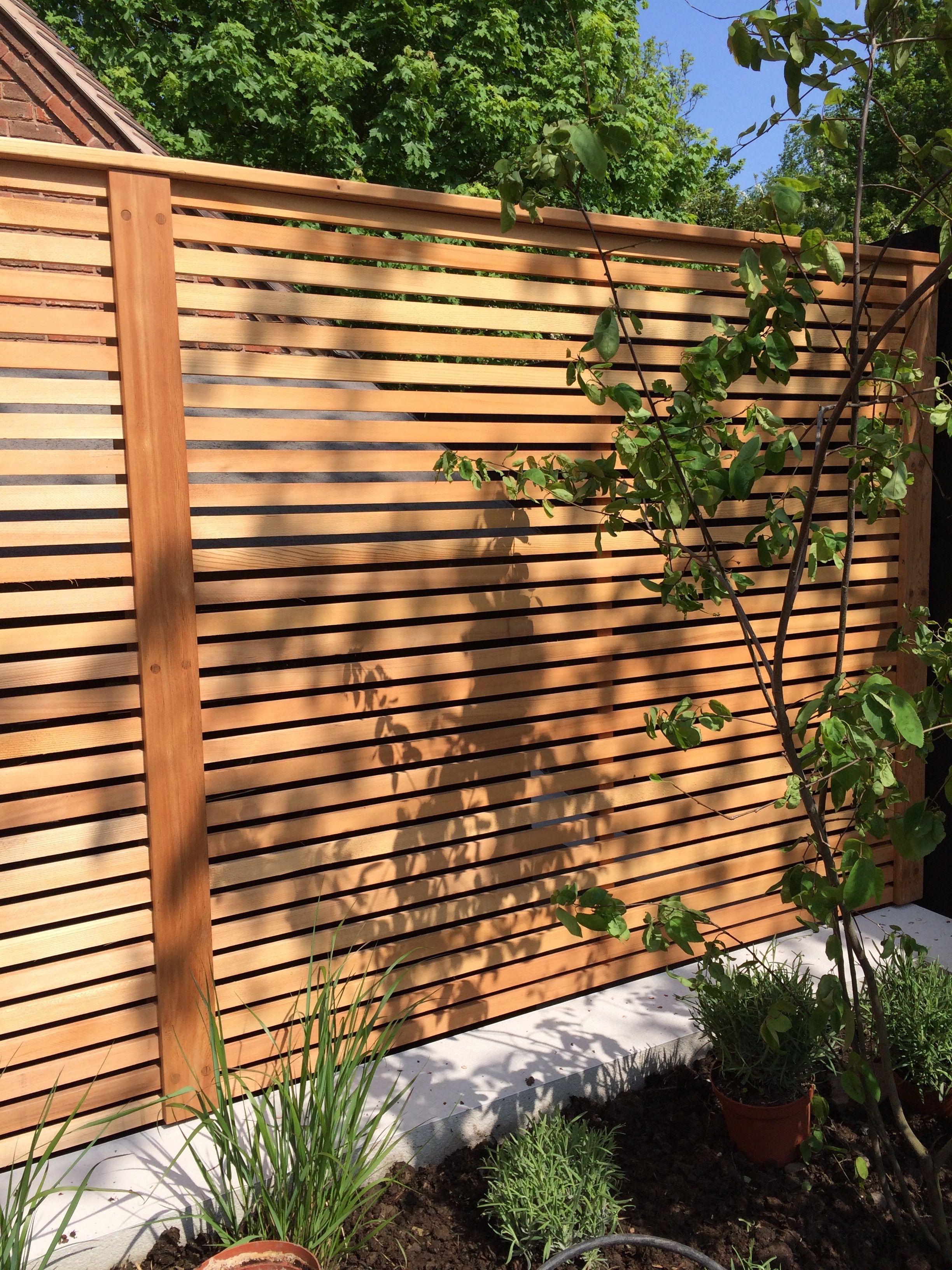 Garapa decking and Cedar screens create modern family garden ...