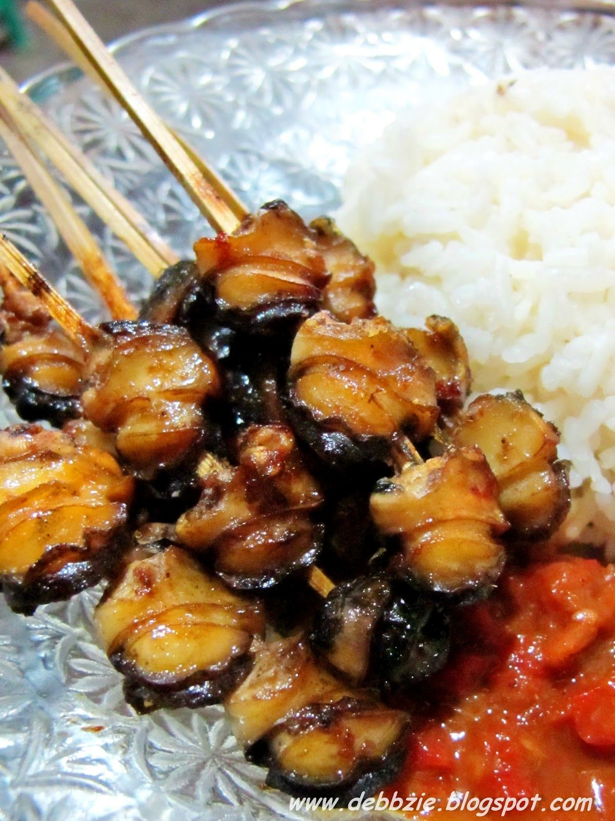 Sate Kakul, the Balinese term for freshwater snail which normally lives in the rice fields. It's marinated with the mixture of shallot, garlic, salt, palm sugar, ginger, etc. Can be served with plecing sauce.