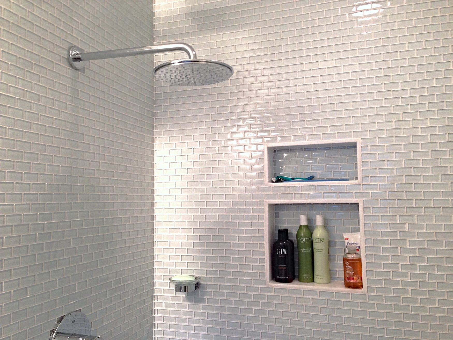 white glass mini subway tile shower walls: found at http://www