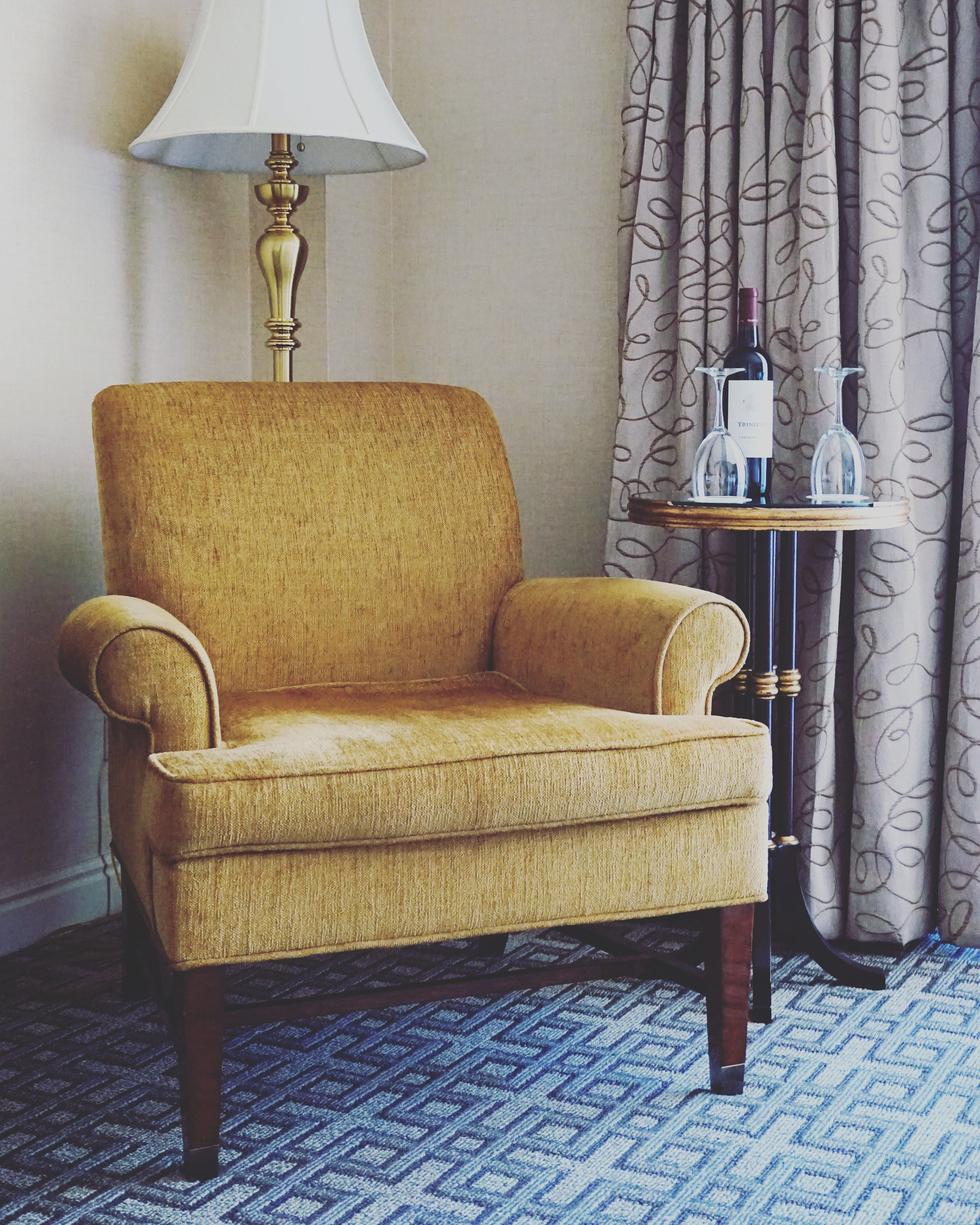 Take a seat, and enjoy a glass of whine at Warwick Denver Hotel featured in A On the Road's blog