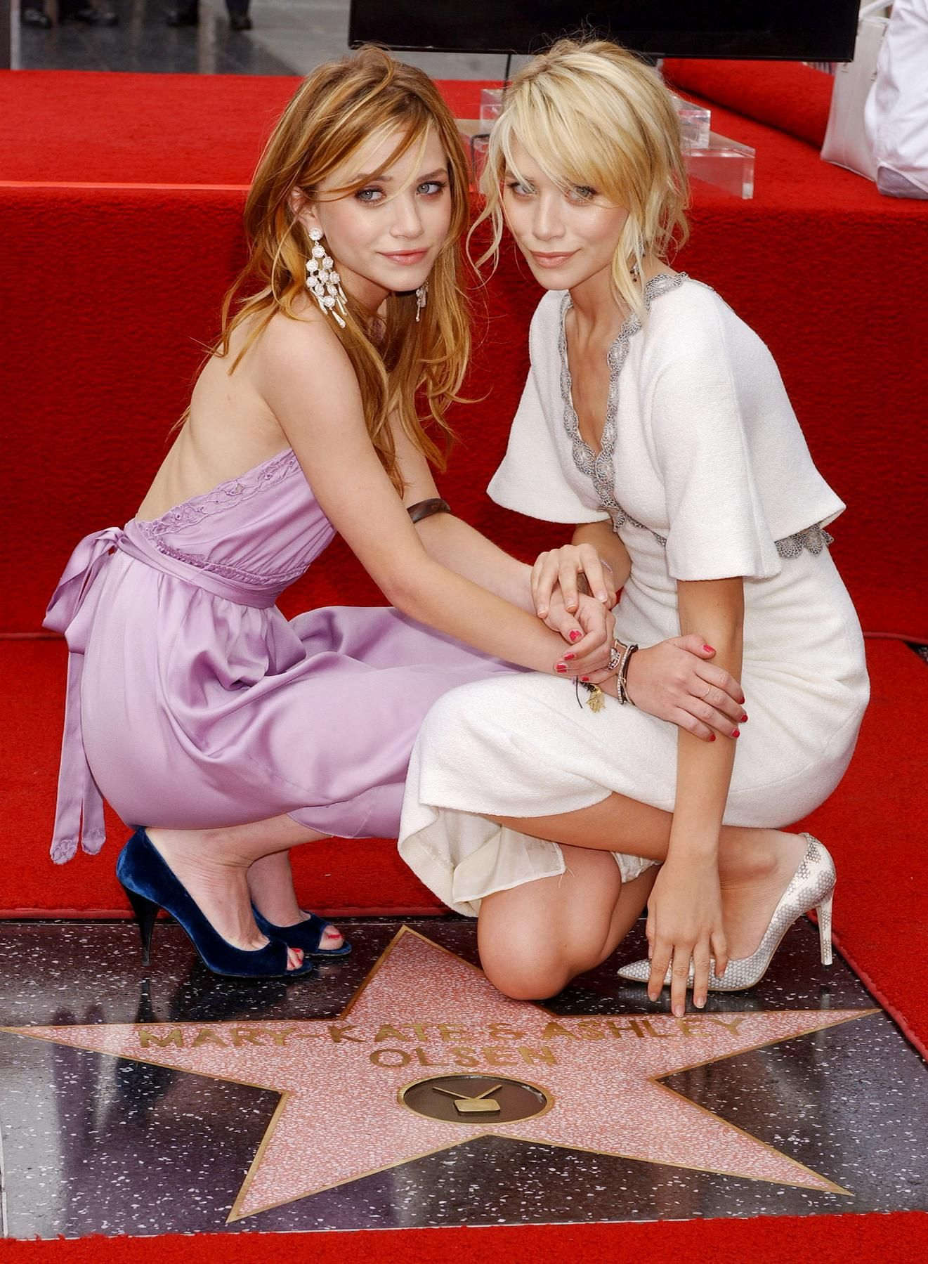 Ashley and Mary-Kate Olsen receiving a star at the Hollywood Walk of Fame, 2004