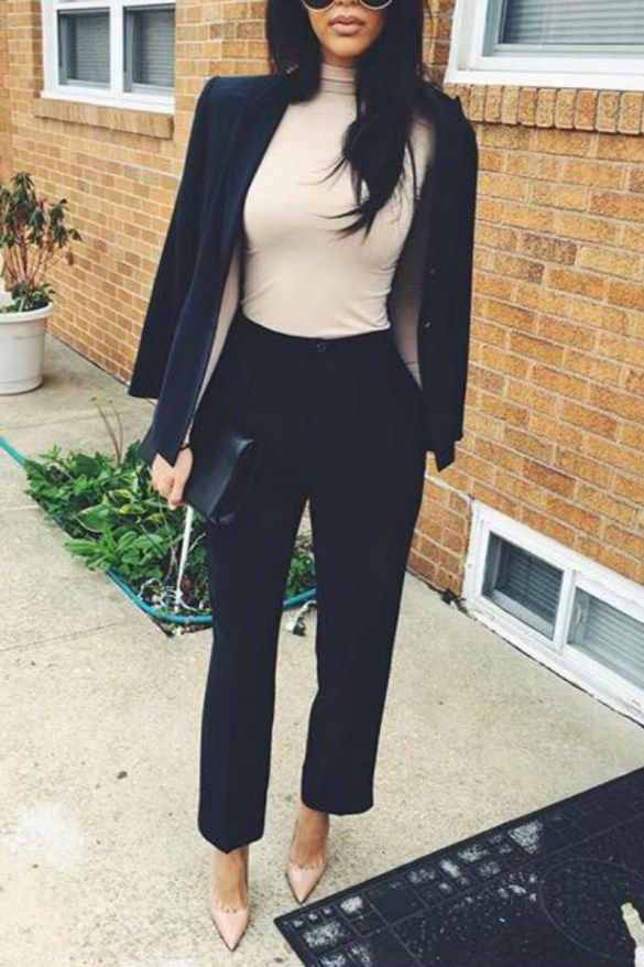 15015d45b06 a women wearing a black blazer and nude turtleneck with black slacks and  nude pointy toe pumps