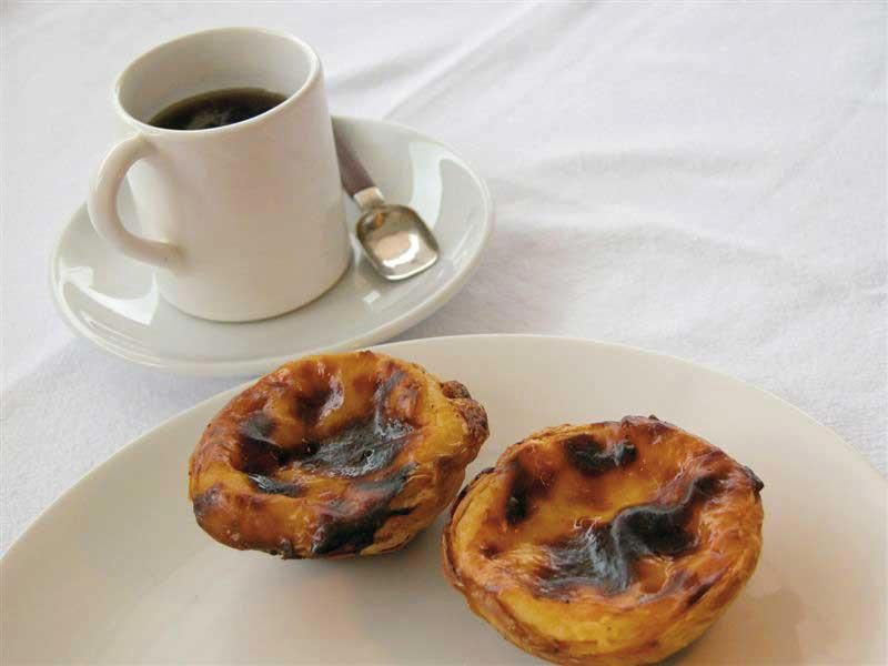 """Nothing like a cup of espresso coffee and one of Portugal's signature pastries, """"Pasteis de Nata"""" (custard tarts) to start up the day:)"""