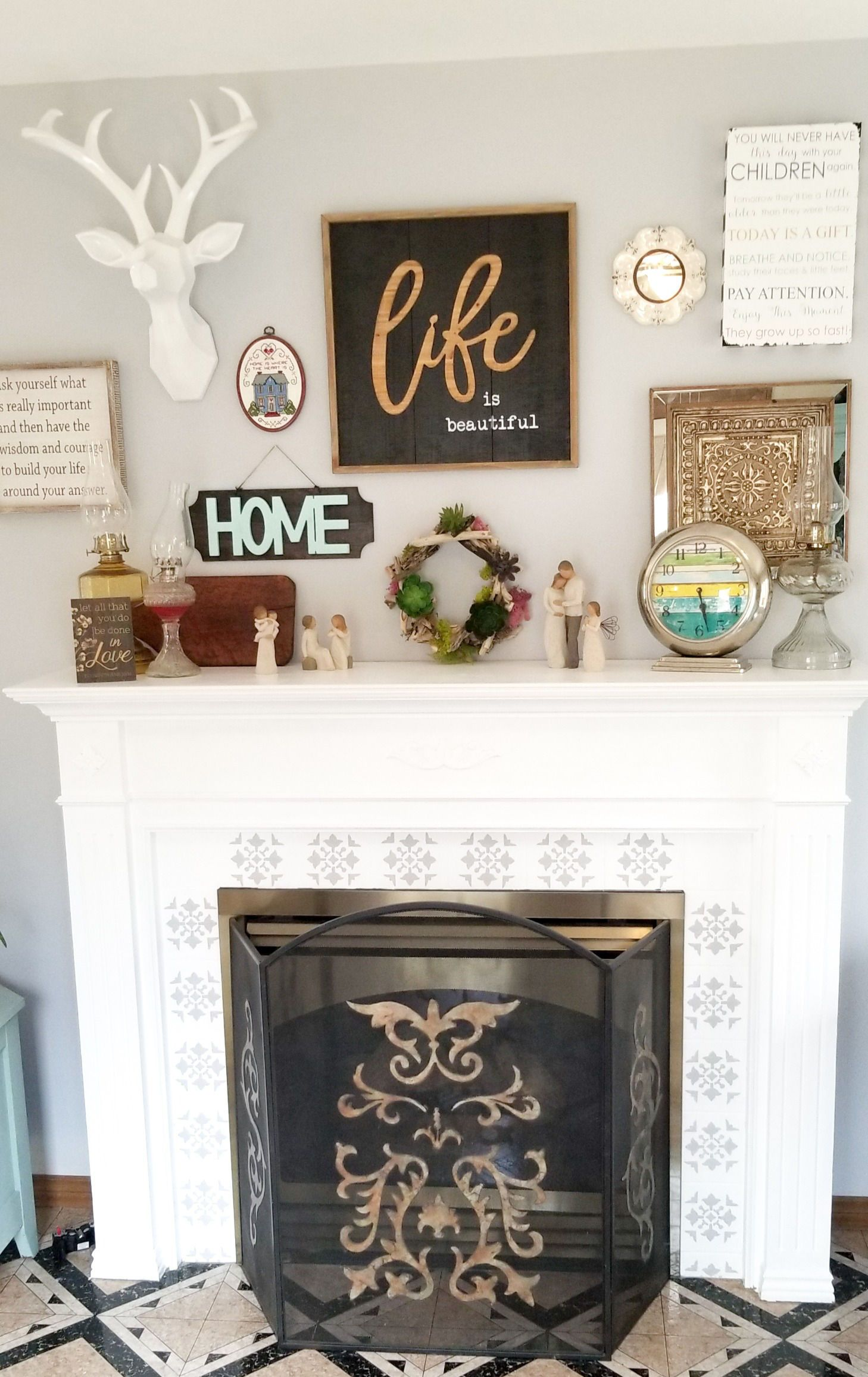 A fireplace surround makeover on a budget with stencils