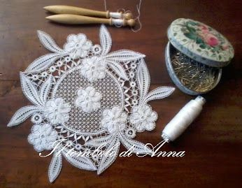 Anna F. She says the pattern is from the Idrija lace school.