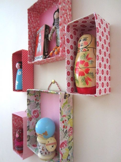 Display boxes hung on the wall-- instructions for making them are included here