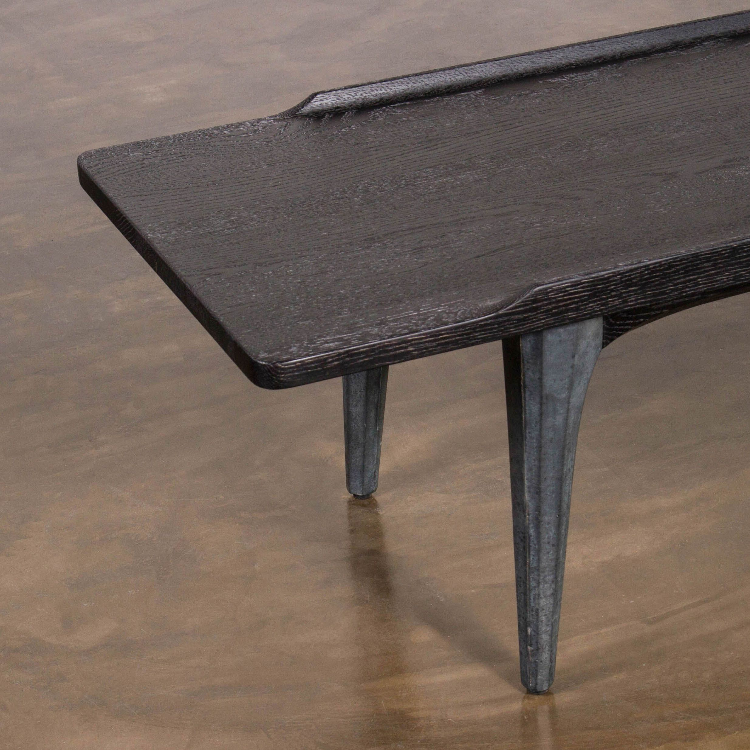 districteight the salk coffee table features sculpted concrete