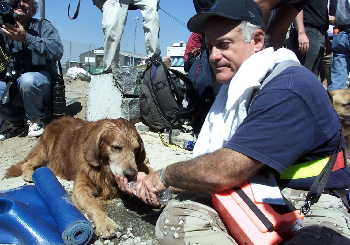 9/11 rescue dog Bear given water at WTC 9-13-01.