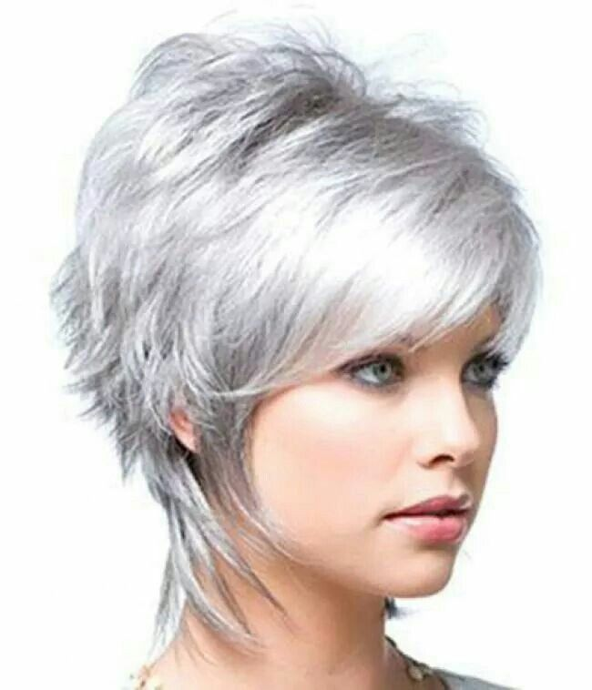 Love the cut!!  I wonder if I can get my hair to do this???