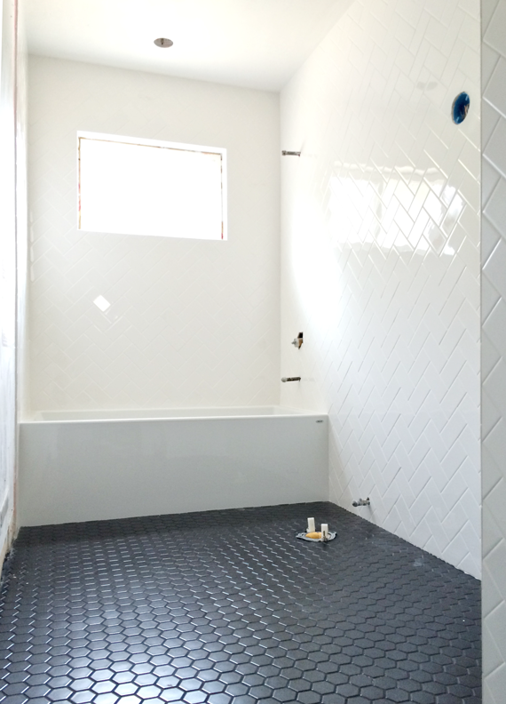 White Herringbone Bathroom Walls // BrittanyMakes Love The Black Hexagon  Tile Floor