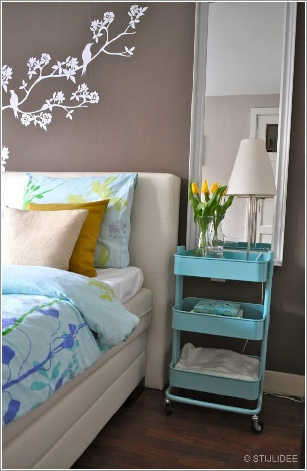 Place An Ikea Cart For Storage On The Wheels That Can Serve As A Nightstand Too When Required