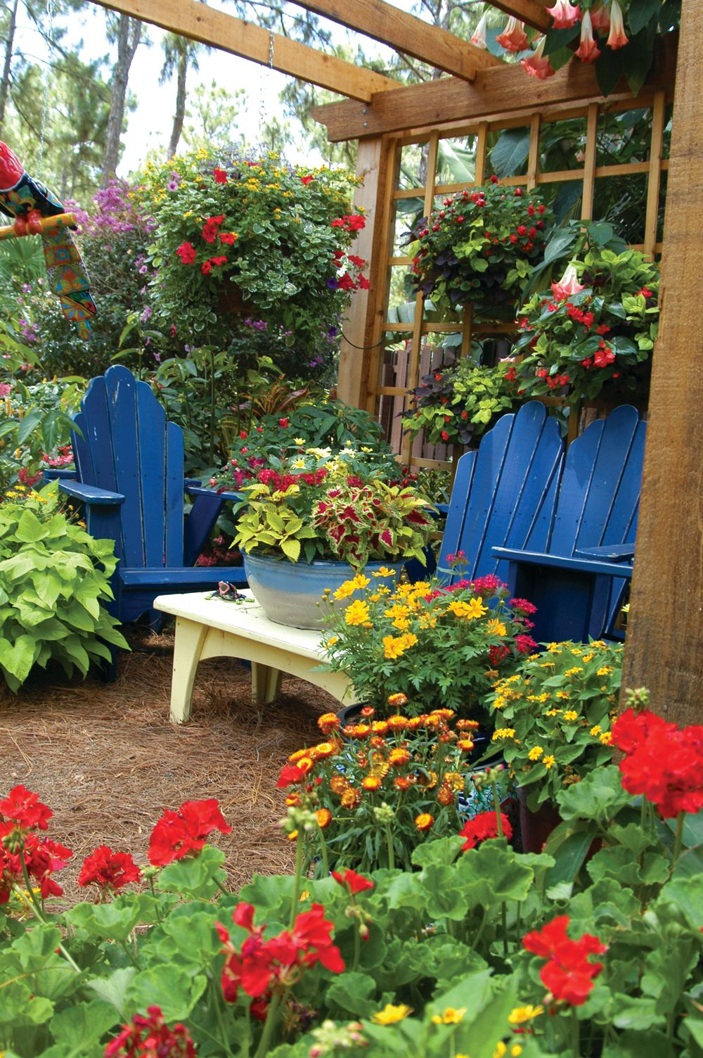 Blue Chairs And A Lovely Arbor Act As A Background For A Lovely Container Garden Pamela Created In This Lake Landscape Design Beautiful Gardens Garden Mirrors
