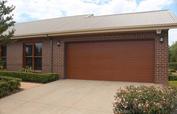 Residential Panel Lift Garage Door Installation Queensland Roller