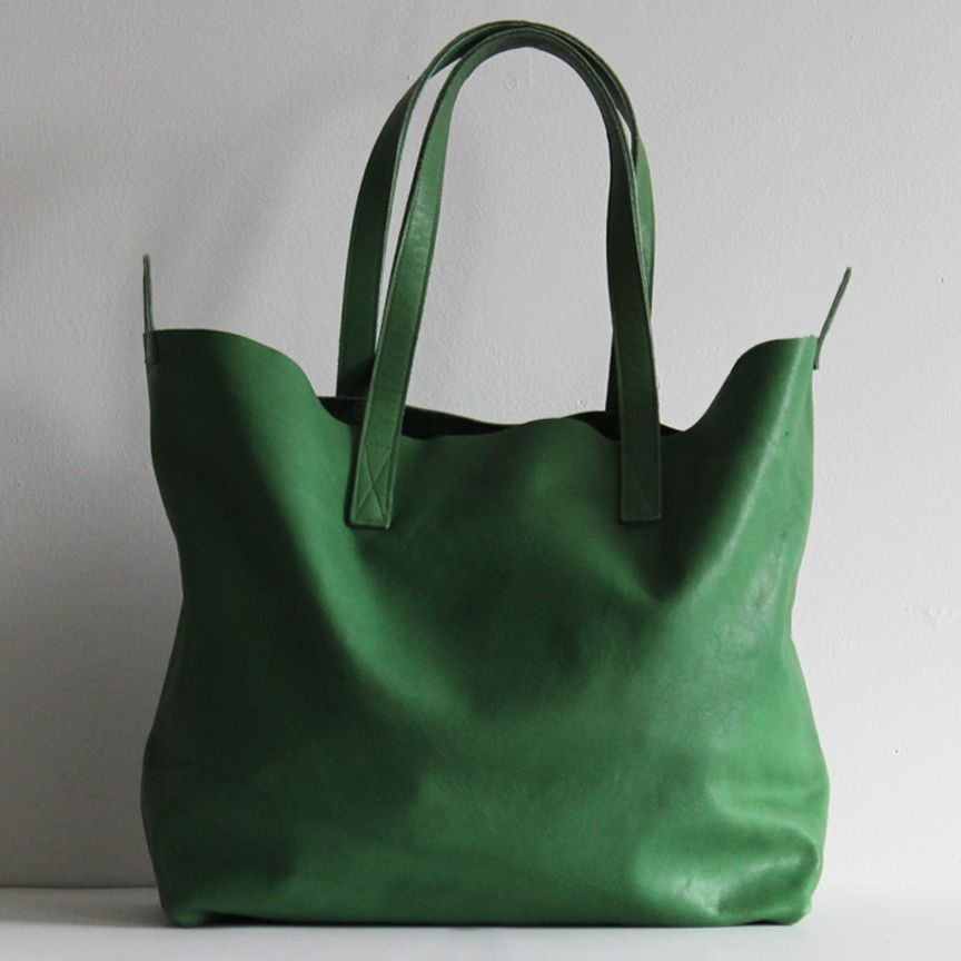 Large, pasture green leather tote bag. Includes a magnetic closure ...
