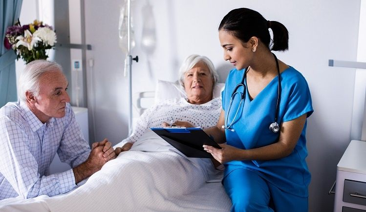 Female doctor discussing options with a senior couple in a