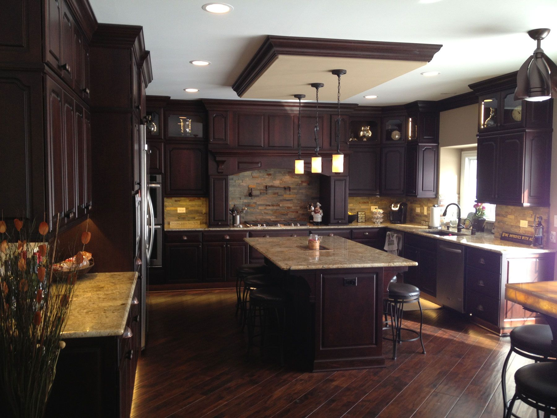 A New Home In Mokena Illinois Has An Elegant Kitchen That Is Outdone Only By The Adjacent Bar Ar Kitchen Cabinets In Bathroom Elegant Kitchens Black Kitchens