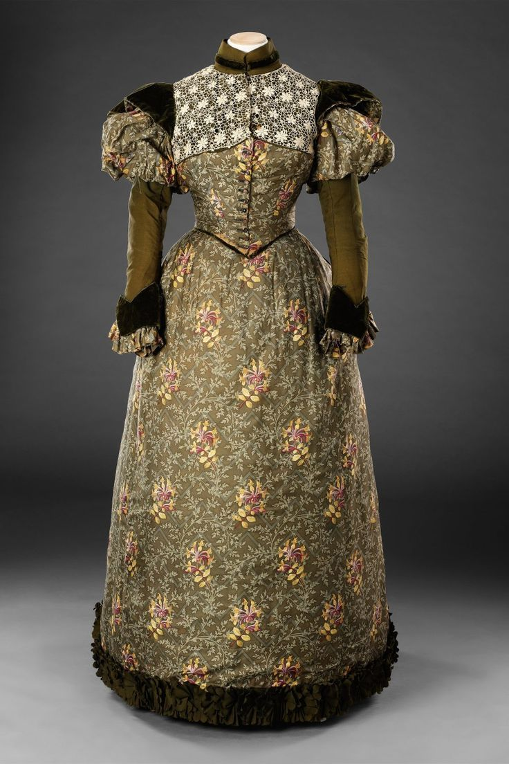 Round gown with juliet sleeves, pecadil-remniscient waist detail, high collar, and floral motifs, circa 1892 Source: The John Bright Collection #edwardianperiod