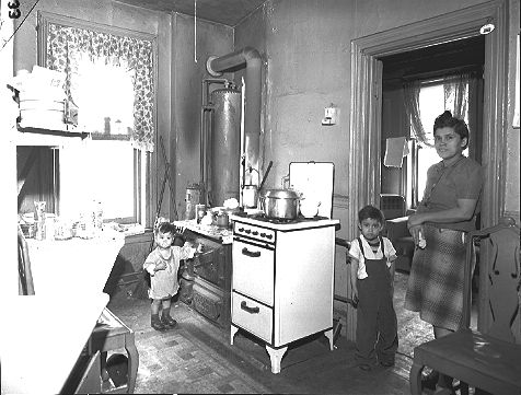 A Woman Poses With Her Children In The Kitchen Of Their Tenement Apartment Brooklyn Near Navy Yard 02 27 1948 Building Would Be Torn Down As