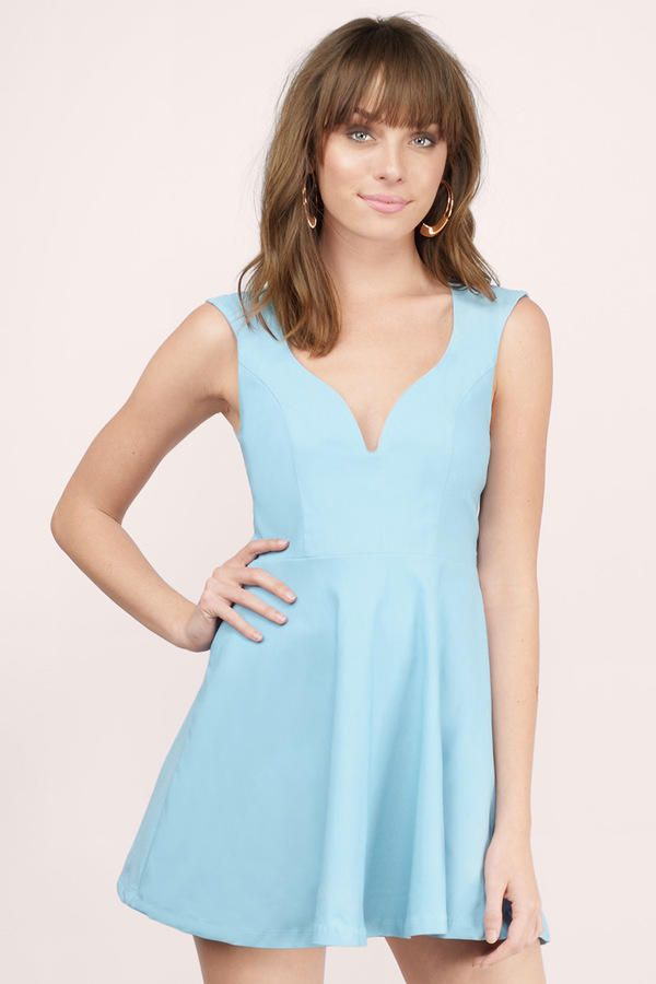 ee97063592e Sweetheart neckline skater dress with a flowy skirt and body fitting top.  There s a single cut out in the back.