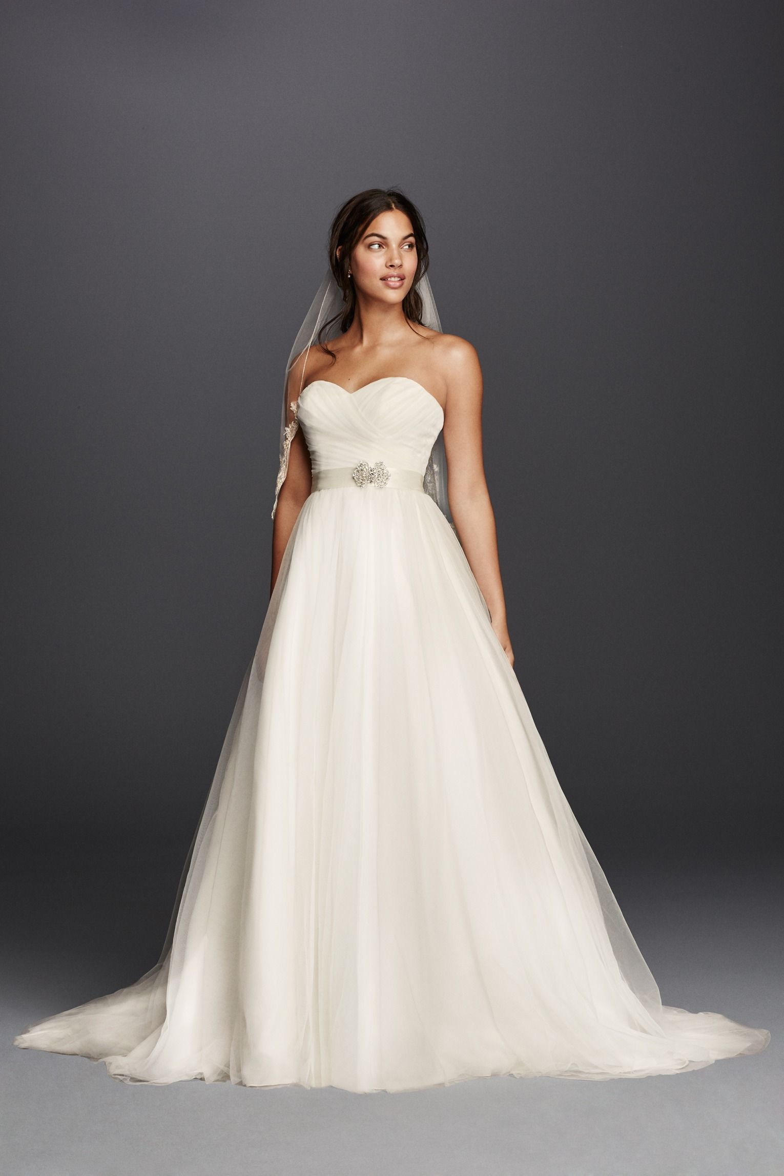 A classic ball gown for the traditional bride the soft pleats and