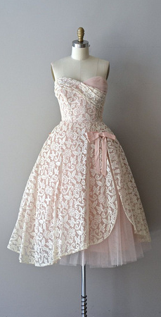 cute dress with straps added and some material on the front to make it modest