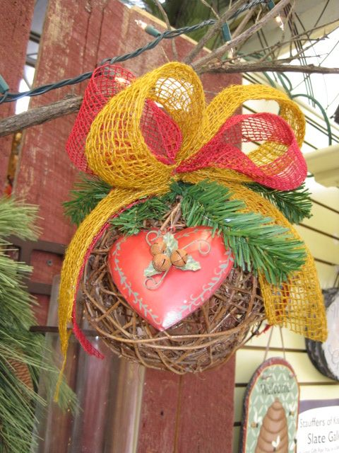 Gold and red holiday kissing ball from the Backyard Guest Theme at Your Christmas Shop at Stauffers of Kissel Hill Garden Centers. (http://www.skh.com/home-garden/departments-2/the-christmas-shop/)