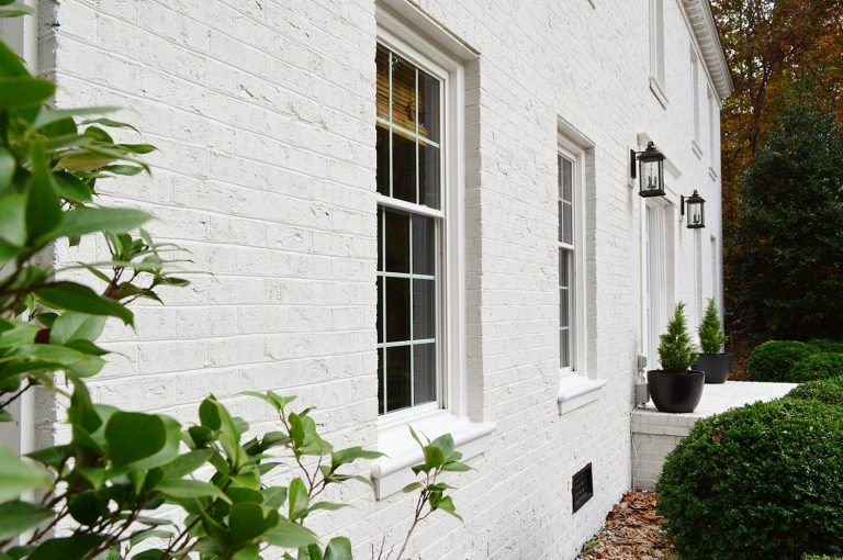 I Love Love White Painted Brick Not To Mention The Rounded Arch Door And The Shuttered W House Paint Exterior Painted Brick Exteriors Exterior Brick