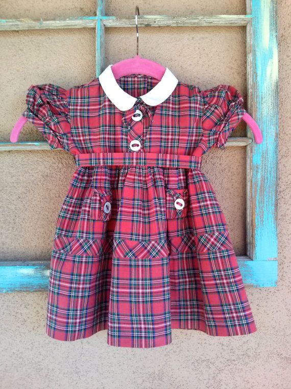 312ac8b23 Red, green, black, blue, white Plaid Cotton Collar is cotton too, white  Puffy sleeves Bow 2 big decorative buttons on front Snaps in front Full  skirt Ties ...