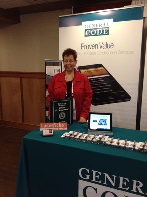 South Floral Park's Village Administrator & Clerk-Treasurer Sally Ponce stands at the General Code booth during the Fall New York Conference of Mayors conference in Lake Placid, New York | #GCclient #southfloralpark #village #newyork #localgov #NYCOM #mayors #conference #lakeplacid