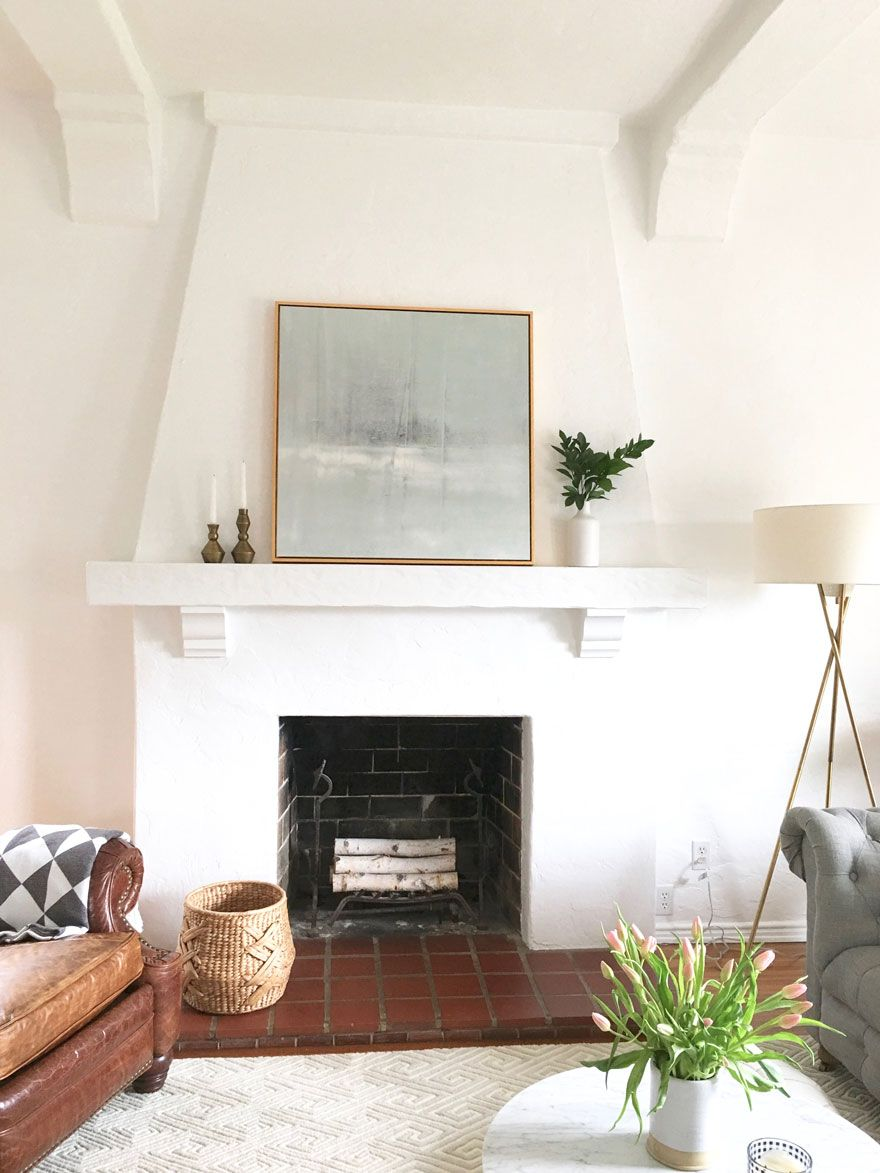 I love the all white fireplace the shape and how she has styled it is simple and perfect