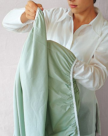 Perfectly folded sheets - Martha makes this look so easy.