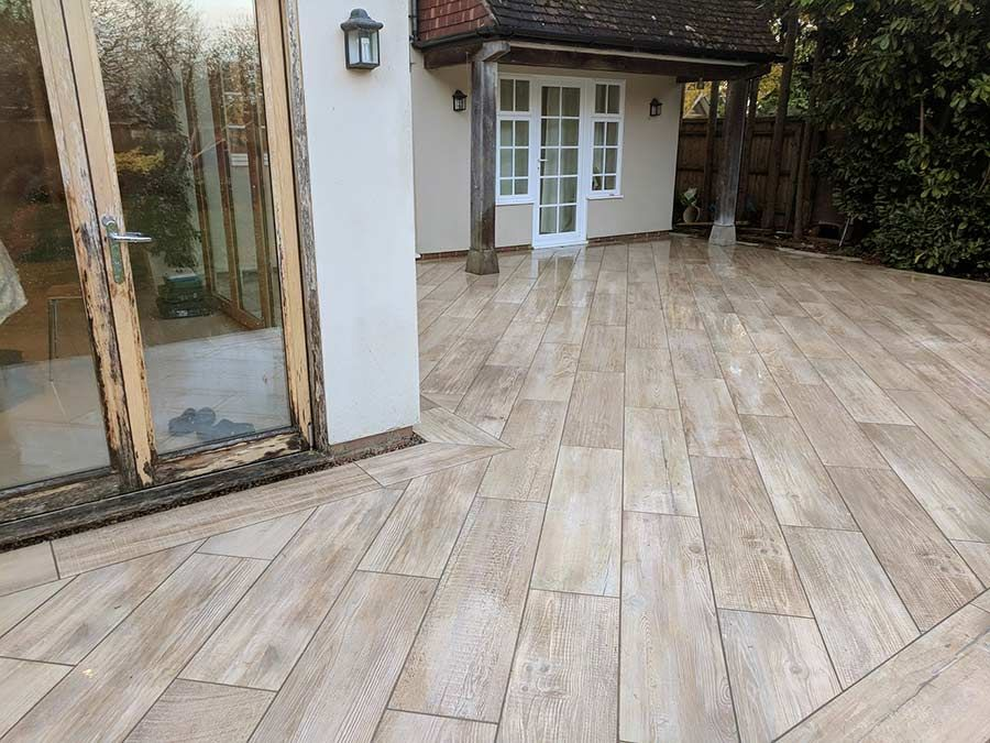 The Awbs Landscaping Team Painstakingly Cut Each Porcelain Paving