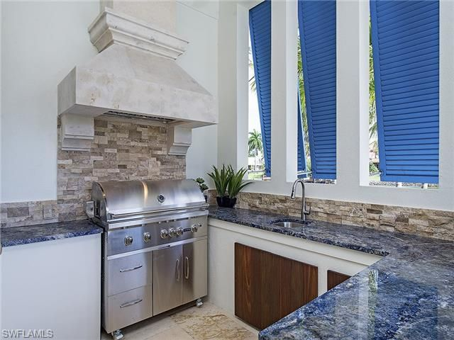 Summer Kitchen With Blue Granite Countertops On Spyglass Lane In Port Royal  | Naples, Florida