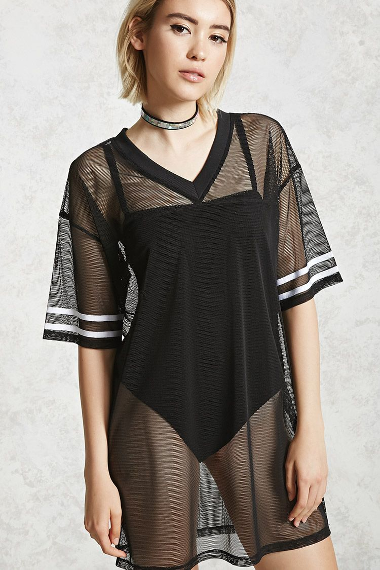 A sheer mesh knit tshirt dress featuring a ribbed vneckline short