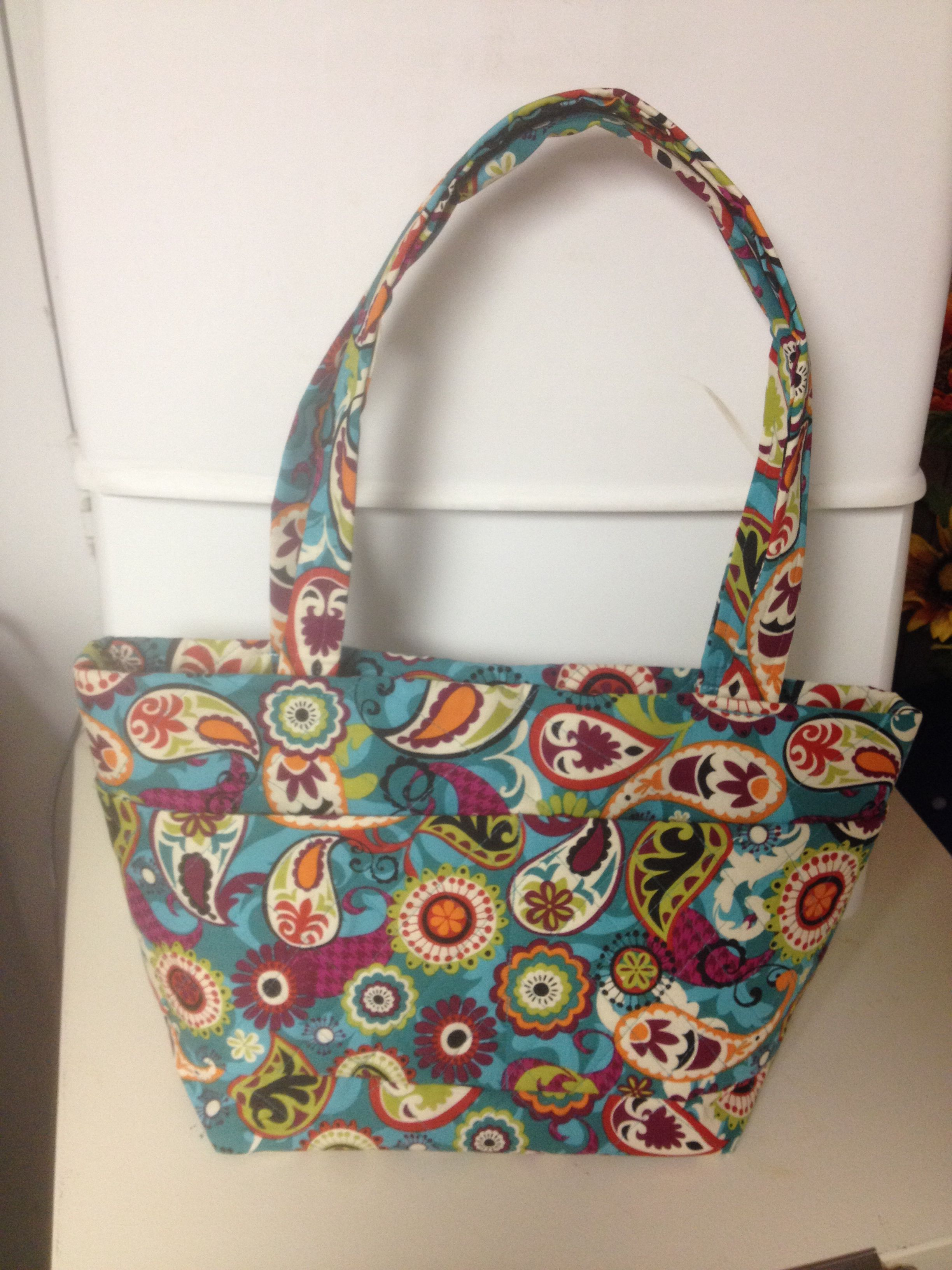 This teal blue quilted purse has several pockets plus an inside zipper pocket in the center. Inside fabric is very whimsy with orange fabric with  white dots. This bag is custom made by Carol Anne Lawrence.  Available today at 8706799126 (4SALE)