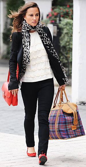 Pippa wearing black and white with red accents